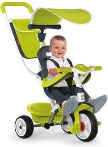 bébé sur tricycle smoby vert