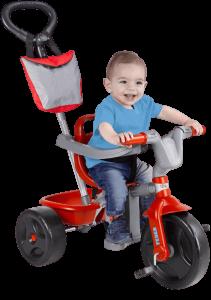 petit garçon assis tient le guidon du tricycle rougecle